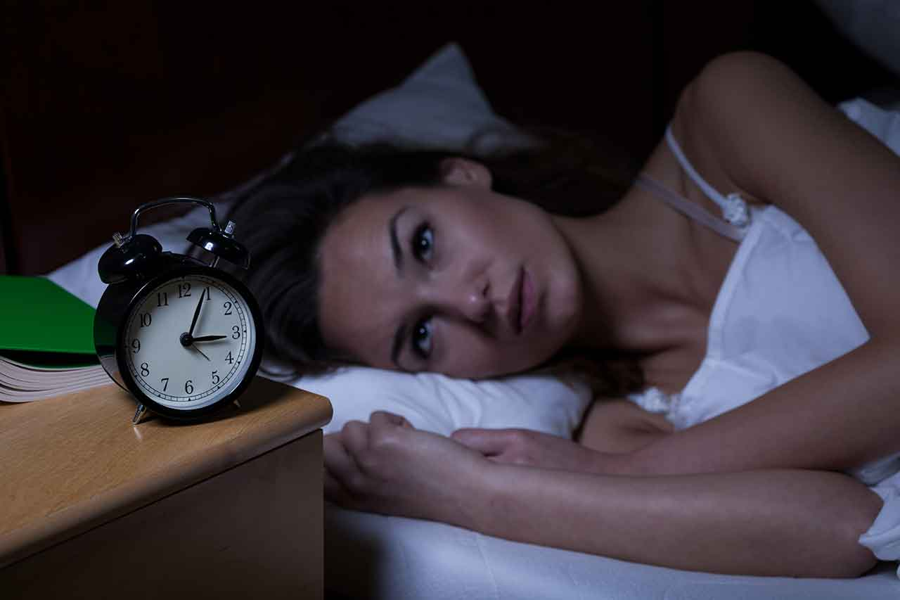 Image of woman lying wide awake suffering with insomnia