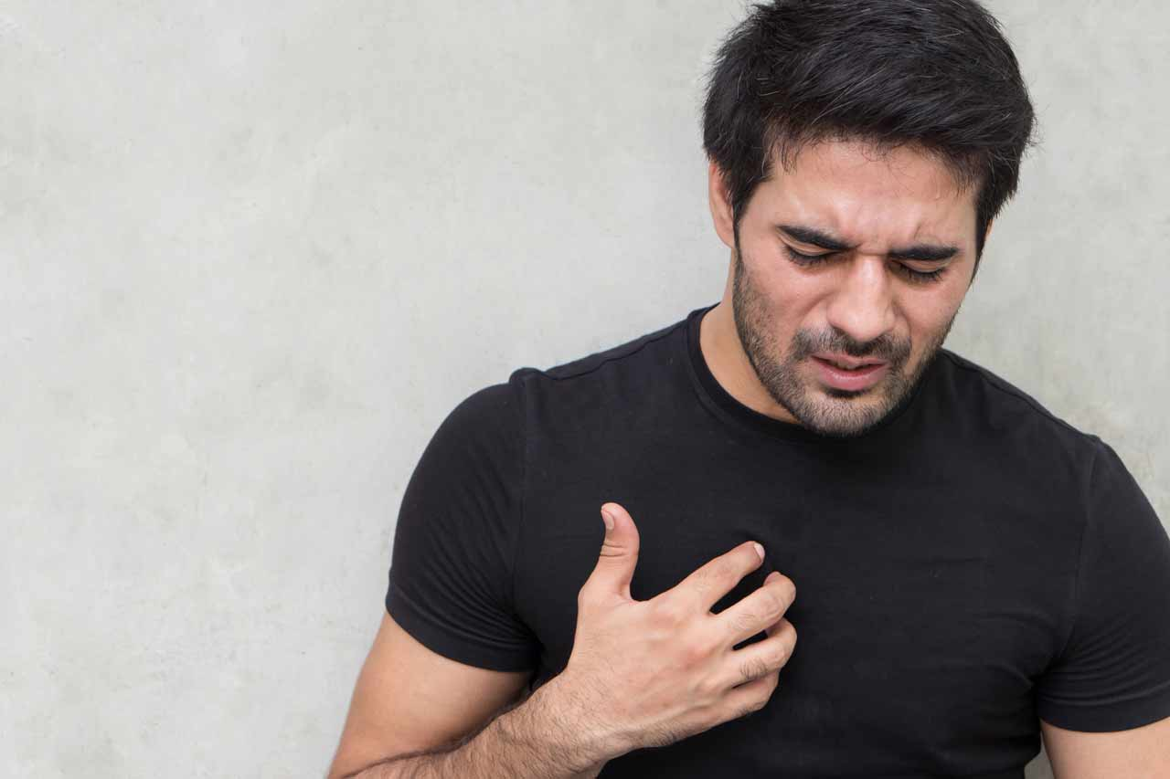 Image of man suffering with acid reflux