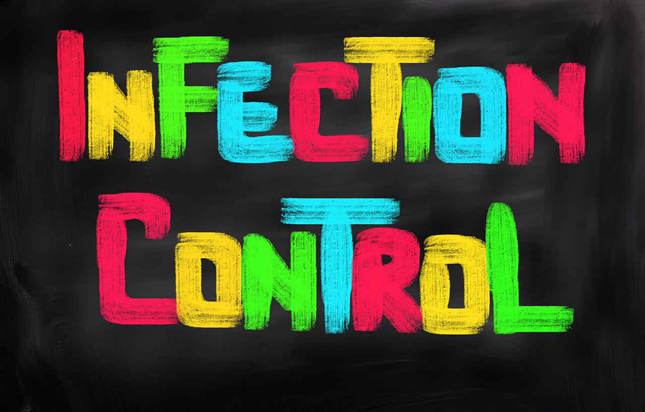 Image of the words infection control on a blackboard